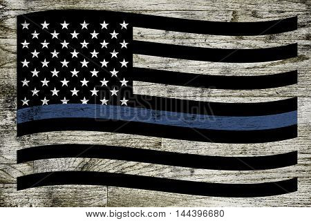 A waving police and law enforcement support flag over a dirty stained wooden board background