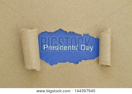 Presidents day written under torn paper .