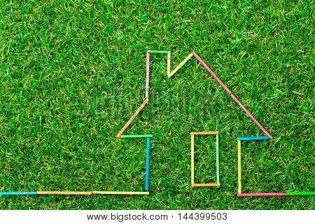 House Icon On Green Field