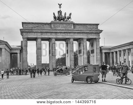 BERLIN GERMANY - APRIL 4 2016: Tourists At Brandenburg Gate in Berlin Germany black and white