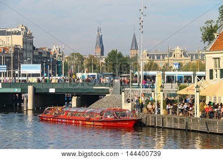 Amsterdam the Netherlands -October 03 2015: Tourist boat on the canal of Amsterdam in historic city centre
