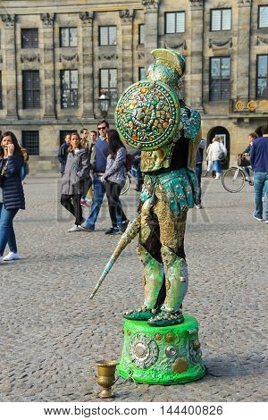 Amsterdam the Netherlands -October 03 2015: Human statue street performer on Dam Square in historic city centre
