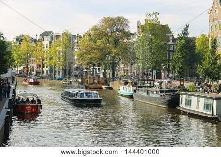 Amsterdam the Netherlands -October 03 2015: Tourist boats on the canal in historic city centre