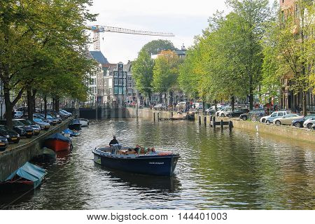 Amsterdam the Netherlands -October 03 2015: Tourist boat on the canal in historic city centre