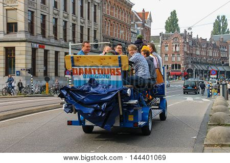 Amsterdam the Netherlands -October 03 2015: People riding excursion bicycle in city centre