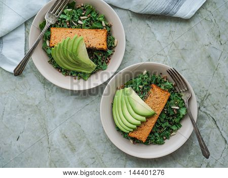 Kale Salad with Buckwheat, Pine Nuts and a Slice of Baked Cauliflower Loaf and Avocado/ Vegetarian Lunch/ Healthy Concept