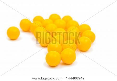 yellow Vitamins pills on a white background