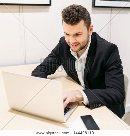 Man at the computer at work businessman office