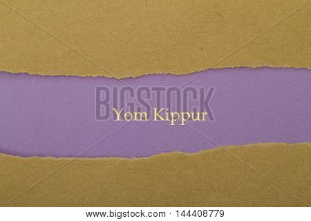 Yom Kippur written under torn paper .