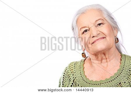Portrait of a smiling senior woman. Isolated over white background.