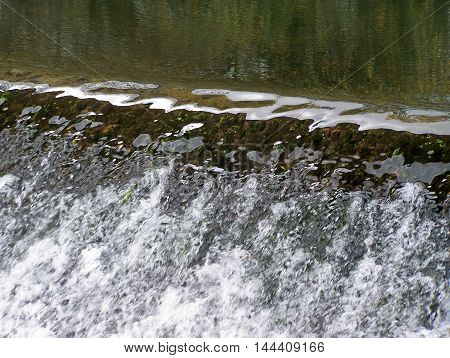 Beautiful waterfall in the river or riverside