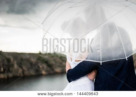 couple under an umbrella in rainy stormy weather