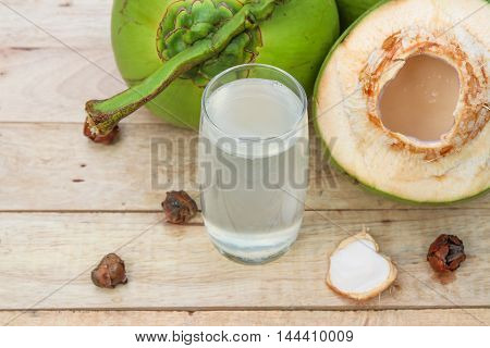 Fresh Coconut Water Drink in glass on wooden  background