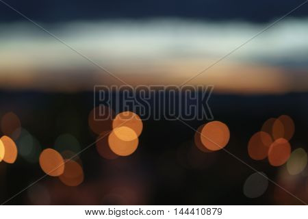 abstract bokeh blurred night city background from above, urban backdrop
