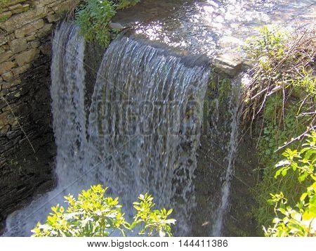 Beautiful waterfall in the riverside (Álvaro - Portugal)