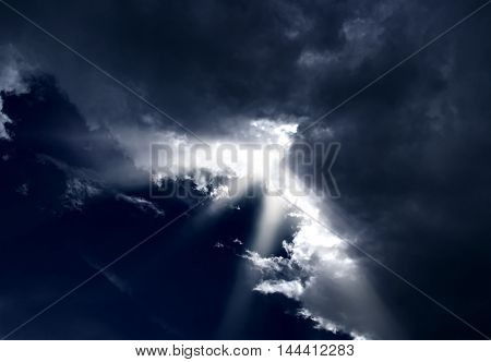 Beam of the sun through storm clouds.