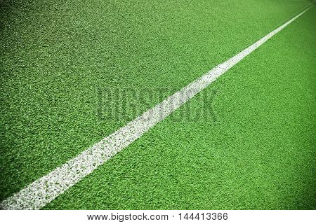 Close up of the green lanes on a running track