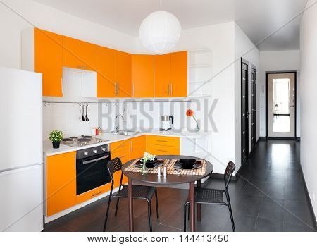 Contemporary orange kitchen with the white walls
