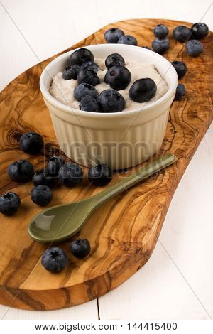 steel cut irish oatmeal boiled with milk and blueberries