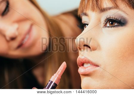 Make-up Artist Applaying Lipstick