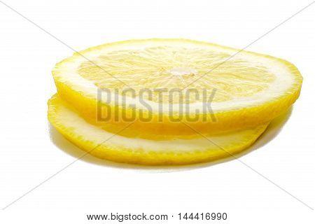 Slices of fresh lemon isolated over white background