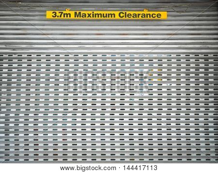 3.7m Maximum Clearance sign at doorway in Perth