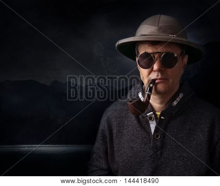 Man In Helmet With A Smoking Pipe