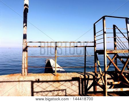 Landscape of the Black Sea and rusty ladder