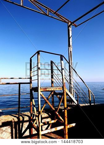 Landscape of the Black Sea and rusty ladder 2