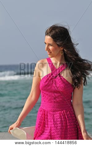 natural portrait of a brunette woman on vacation at the Cayman Islands