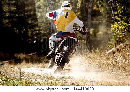 back is racer racing sport bike during a competition in motocross