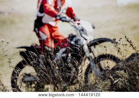 in background racer racing sport bike during a competition in motocross
