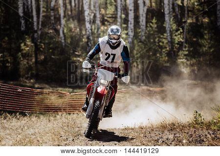 athlete on racing sports motorbike during a motocross competition