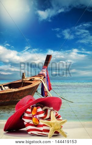 Beach bag on the beach with Thai long tail boat