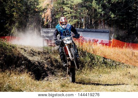 male rider on a motorcycle when racing Enduro riding on rear wheel