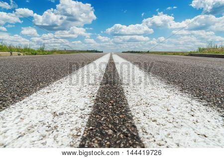 two white line on asphalt road closeup