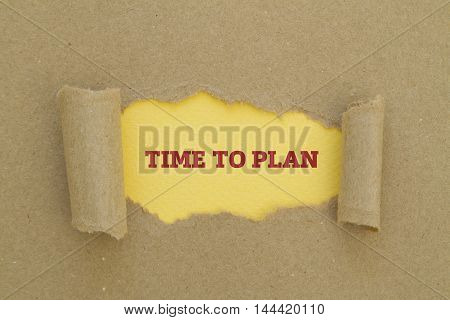 TIME TO PLAN message written under torn paper.