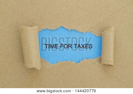 TIME FOR TAXES message written under torn paper.