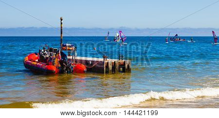 SOPOT, POLAND - AUGUST 24, 2016: Lifeguard Rescue Boat moored at a pier for of civil protection during windsurfers in a competition in Sopot.