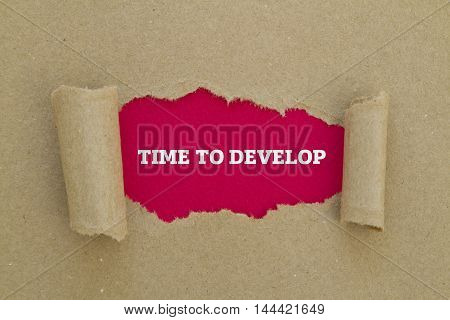 TIME TO DEVELOP message written under torn paper.