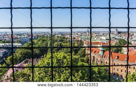 Krakow Poland - August 26 2016: Krakow landscape seen from behind bars.
