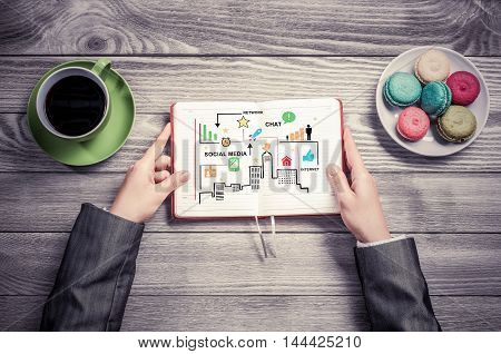 Top view of female hands and business strategy in notebook