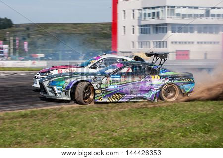 Nizhny Novgorod Russia Aug 20, 2016 : Russian Drift Series Stage 5 RDS Zapad West 2016 Smirnov Pavel vs Ekaterina Sedykh. Nissan Silvia S15 Toyota Supra