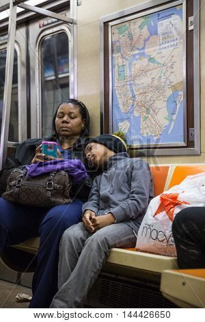 Black Woman With A Child In New York City Subway