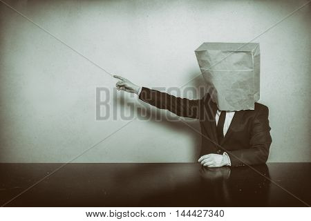 Vintage businessman sitting at office desk with laptop