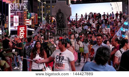 NEW YORK UNITED STATES. AUGUST 24TH 2016. Tourists in Times Square at evening hours.