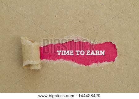 TIME TO EARN message written under torn paper.