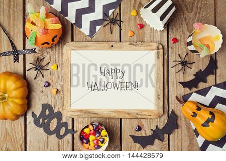 Halloween holiday poster mock up template with pumpkin and candy. View from above