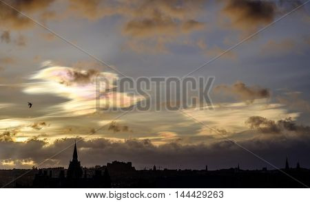 Rare occurrence as nacreous clouds colors the early morning sky in Edinburgh Scotland