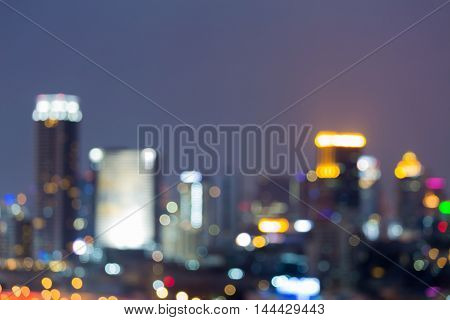 Blurred bokeh lights office building downtown night view